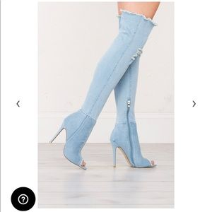 Over the knee distressed denim boots